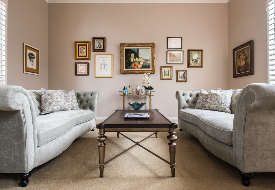 neutral couches with gallery wall